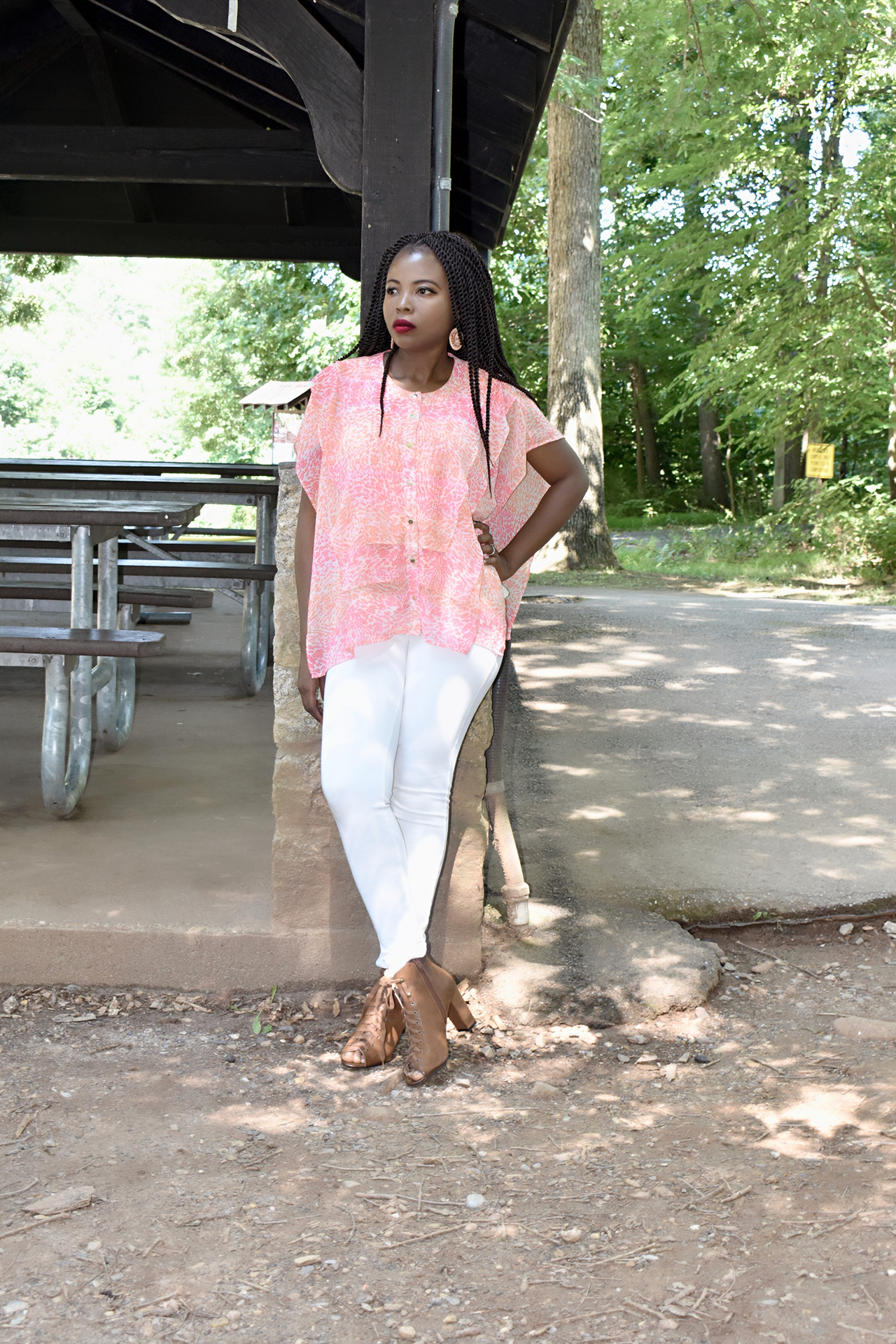 Silk top with ruffles, white skinny pant and  booties outfit. + Amazing deals on summer tops. graphic